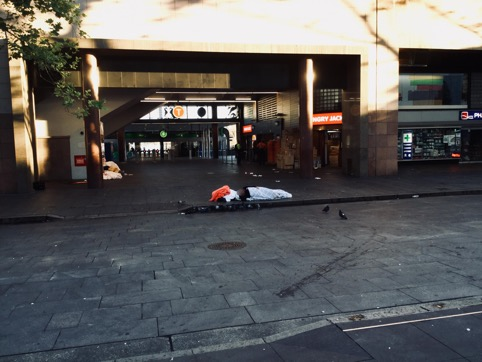 Man sleeps homeless at Circular Quay Sydney